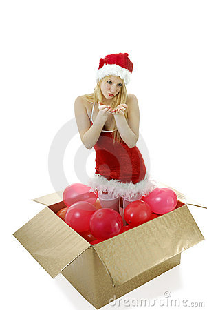 Young blond santa girl in a box blowing kisses