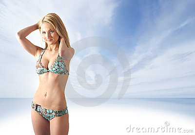A young blond is standing in light blue lingerie