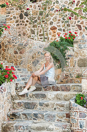 Free Young Blond Tourist Woman Sitting On Ancient Stone Stairs In The Old City, Alanya, Turkey. Royalty Free Stock Images - 75310659