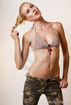 Young blond woman in camouflage