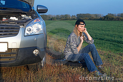 Young Blond Woman With Her Broken Car