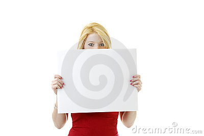 Young blond woman hiding behind an ad space