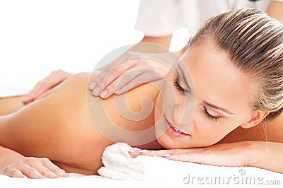 A young blond woman on a massage procedure