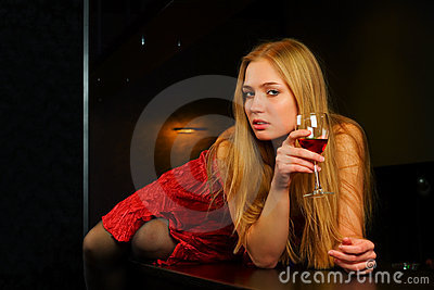 Young blond woman in a night bar