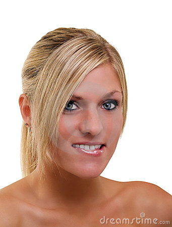 Young blond woman portrait biting lower lip