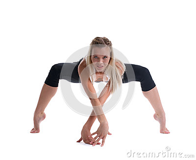 Young blond woman stand in spider yoga pose