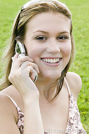 Young blond woman talking on her cell phone