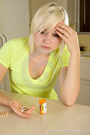 Free Young Blond Woman With Medicine Pills Royalty Free Stock Images - 17978899