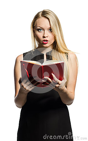 Young blond  wonders with notebook