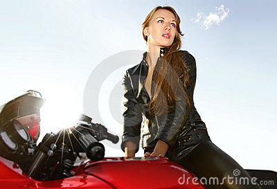 Young blonde on a big red motorcycle