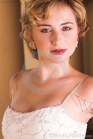 Young blonde bride in white