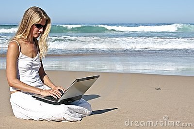 Young blonde business woman working on her laptop