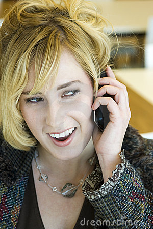 Young Blonde Caucasian Woman Answering Phone