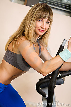 Young blonde exercising on stepper equipment