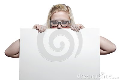 Young blonde girl hiding behind white board
