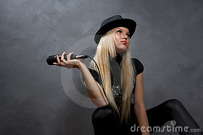 young blonde girl with microphone