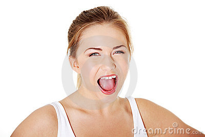Young blonde girl screaming.