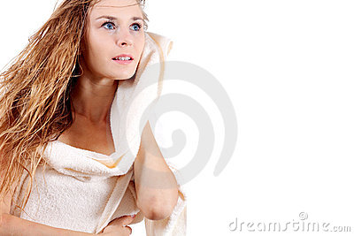 Young blonde girl with white towel
