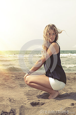 Free Young Blonde Hair Girl Relaxing On The Beach Sand. Wind In Her Blond Hair Stock Photo - 58513120