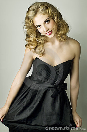 Young blonde lady in black dress