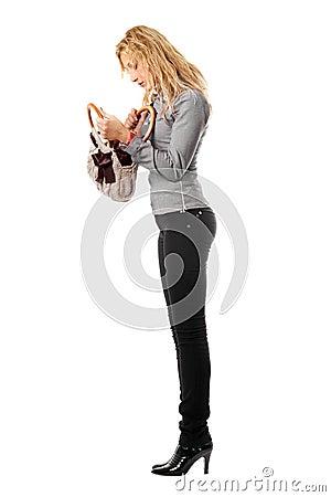 Young blonde looks in her handbag