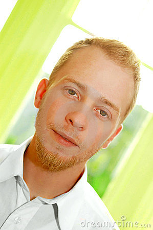 Young blonde man in white shirt