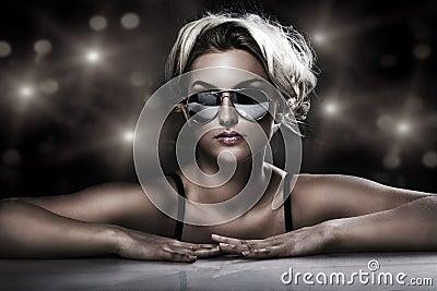 Young blonde wearing stylish sunglasses