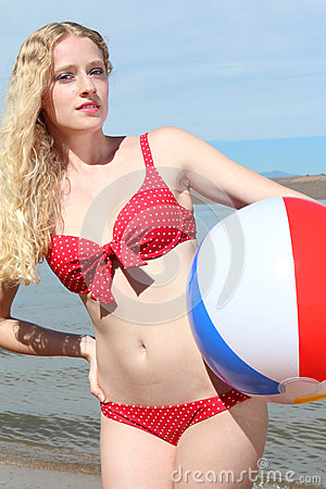 Young Blonde Woman with a Beach Ball
