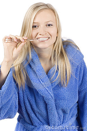 Young blonde woman brushing teeth