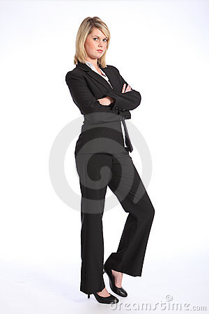 Young blonde woman in business suit arms folded