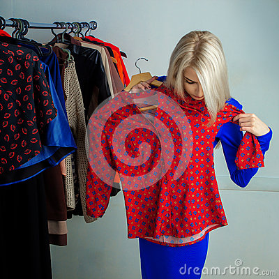 Free Young Blonde Woman Choosing Shirt In Clothing Store Stock Photos - 67104963