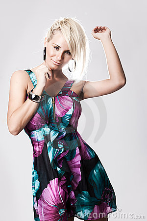 Young blonde woman in colorful dress