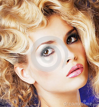 Young blonde woman with glamour makeup and hairstyle waves close up Stock Photo