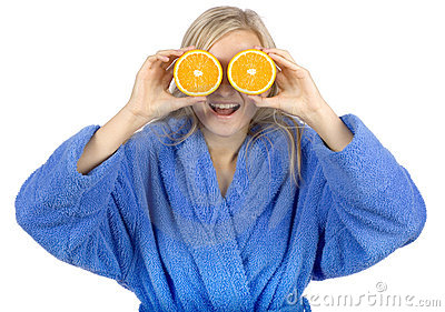 Young blonde woman with halfs of orange