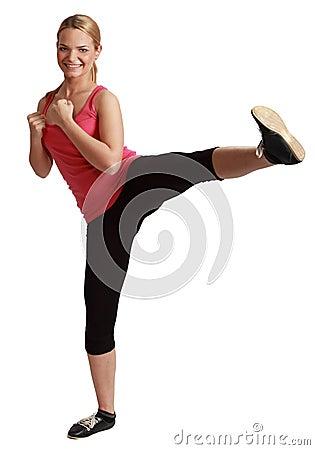 Young Bonde Woman Kickboxing