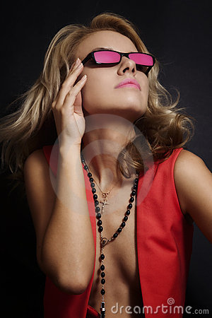 Young blonde woman in pink glasses