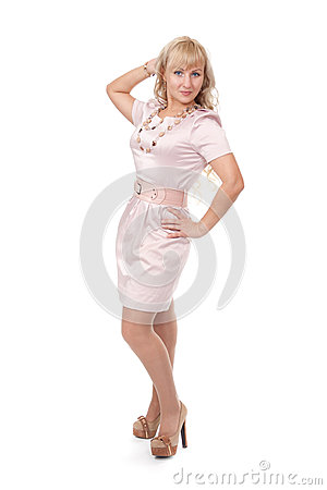 Young blonde woman posing in stylish dress
