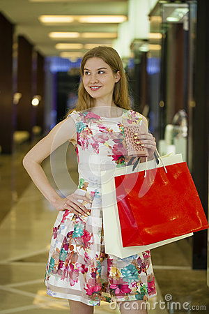 Free Young Blonde Woman With Some Shopping Bags In The Mall Royalty Free Stock Photo - 74280495