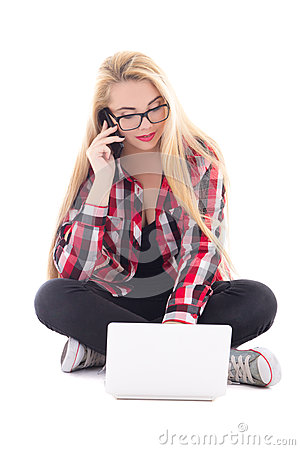 Young blondie woman sitting with laptop and mobile phone isolate
