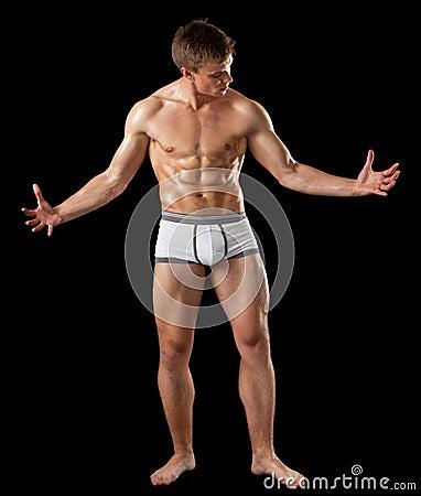 Young bodybuilder demonstrates posture