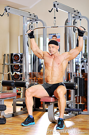 Young bodybuilder training in the gym