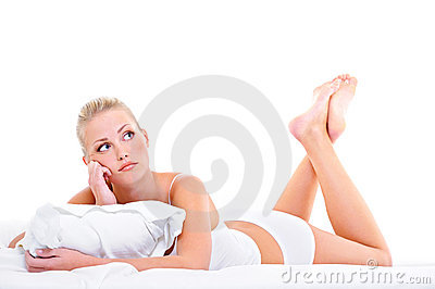 Young bored woman lying down ot he bed