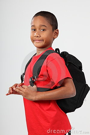 Young boy 9 ready for school with his back pack