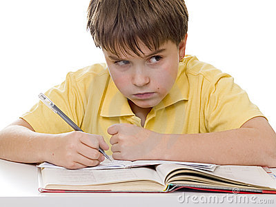 Young boy angry with homework