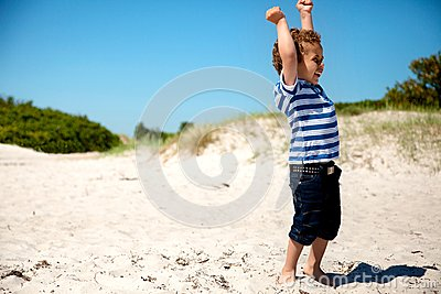 Young Boy  with Arms Stretched Looking Happy