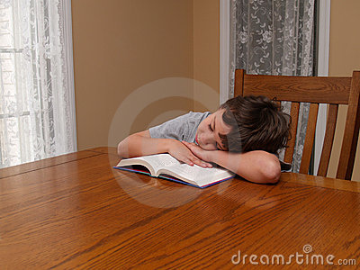 Young boy asleep while reading