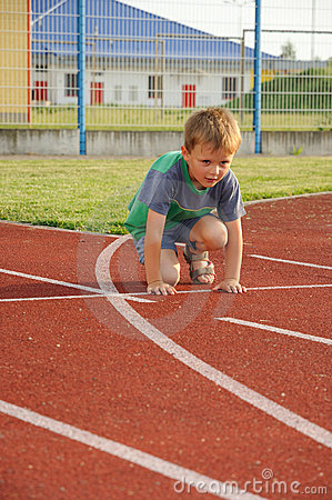 Young boy on athletic stadium