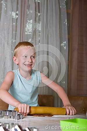 Young Boy Baking Cookies Royalty Free Stock Image - Image: 26226696