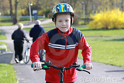 Young boy on bike.
