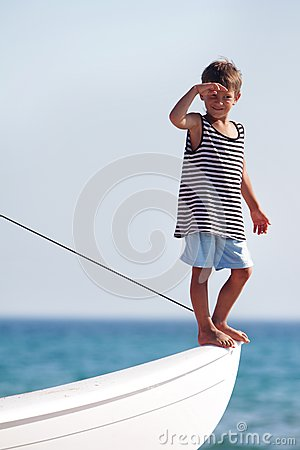 Young boy on board of sea yacht